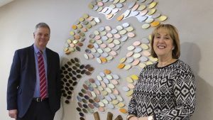 Darlington Building CEO Andrew Craddock with the St Teresa's Hospice CEO Jane and the memory tree