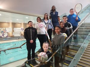(L-R) Move More Officer Mark Dobinson, Darlington Building Society's Financial Support Officer, Alison Etherington, Darlington Cares' Programme Officer Chelsea Johnson and Martin Gray Academy Head Coach Dean Browne with pupils from Red Hall and Corporation Road Primary Schools