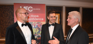 Paul Davison, managing director of Erimus Insurance, Lewis Kaid, account executive of Erimus Insurance, and Ray Mallon, MFC Foundation chair of trustees.