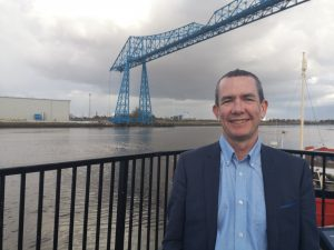 Graham Tyerman, MD of Steel River Consultants, which has been chosen to appear in the Parliamentary Review, in front of the Tees Transporter Bridge